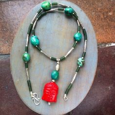 Arizona Turquoise Coral Buddha figure and silver necklace £119.00