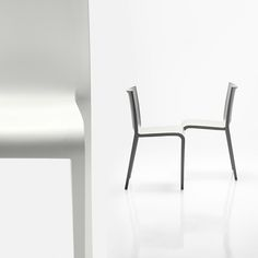 Nassau 1.0 in white. Stackable air molded polypropylene chair.