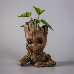 An adorable planter that looks like baby Groot in which you can put your favorite plant… or pencils! That's probably what I would use it for since I'm not very good at keeping potted plants alive. I am Groot! [Guardians of The Galaxy Baby Groot Planter] Baby Groot, Groot Action Figure, Star Lord, Guardians Of The Galaxy, Flower Pots, Planting Flowers, Potted Flowers, Small Flowers, Hand Carved