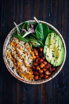 The Vegan Buddha Bowl // quinoa, chickpeas, vegetable oil, salt, smoked paprika, chili powder, turmeric, oregano, red bell pepper, lemon juice, fresh coriander, mixed greens, avocado, sesame seeds