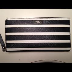 "Kate Spade Brightwater Drive Neda Wallet Lightly used. Zip closure. Kate Spade saffiano textured wallet with gold tone hardware. Full length slip pocket in back. 12 card slots. 2 bill compartments. Central coin compartment. 7.75""Lx 4""h x1""w kate spade Bags Wallets"