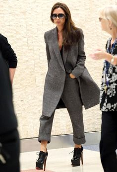 Victoria Beckham knows how to travel in style. The designer wore pair of gray trousers, which she paired with a matching waistcoat over a black shirt for a recent trip.