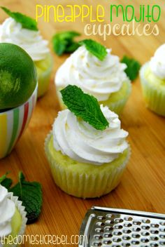 These Pineapple Mojito Cupcakes will transport you straight to the beach! Moist pineapple cupcakes topped with a fabulous mojito mint frosting tastes like a frosty, refreshing mojito beverage!