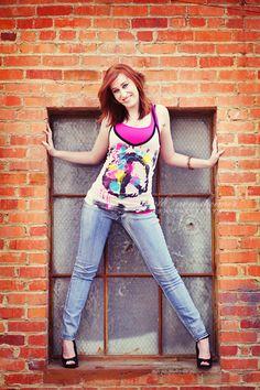 A daring pose in a basement window! Great idea. Create angles like she did.