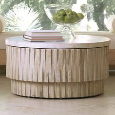 Stone from the desert of Rajasthan is hand chiseled and sculpted by artisans to create this sculptural table. The table has a removable terrazzo top and four adjustable nylon glides on the base. The table can be used indoors or outdoors.