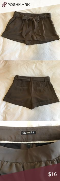 Express Satin Dress Shorts These are olive colored satin dress shorts that feature a removable sash/bow. Purchased from Express. Size 2. Very gently used, in excellent condition! Only worn a handful of times. 😎Offers Welcome! ❌NO TRADES❌ Express Shorts