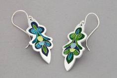 Feel like a goddess in these lovely Cloisonné and Champlevé enamel earrings! Dimensions: 18mm x 36mm Materials: Enamels on fine silver. Sterling silver ear wires.