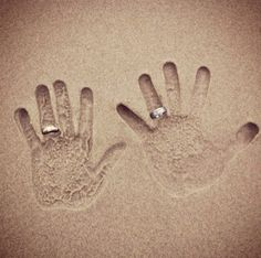 so creative. hand prints in the sand with wedding rings