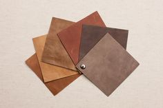 VINTAGE LEATHER. From left: Terracotta, Desert, Cattail, Burnt Umber, Bark, Ash