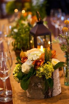 Fall Table, wooden vase with cool greens, creams and warm oranges.