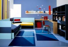 Colorful bedroom for boy. Blue , light blue and some yellow and red for contrast