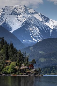 lakeside cabin, with only mountains surround.,,,,, that's a rocky mt high ~~~