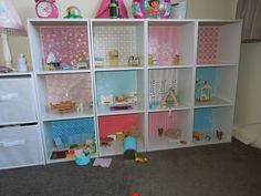"""Our new Sylvanian Families house - cheap bookshelves with scrapbooking paper as """"feature"""" wallpaper."""
