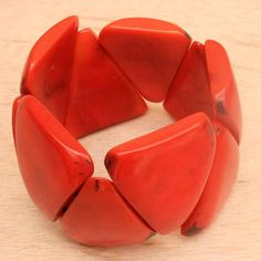 Lorinda's Thoughts I really do like the Artisans in the Andes Bold Orange Triangle Tagua Beaded bracelet! It feels nice and smooth. There is some weight to it which I like. The size might be a little big for my skinny wrist, but it has not fallen off yet! I really like the unique triangle...