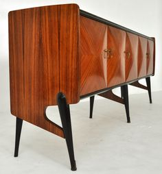 $8,000 1950's Italian sideboard attributed to Ico and Luisa Parisi. Italian ribbon mahogany with ebonized legs and original gold glass top. **Ma...