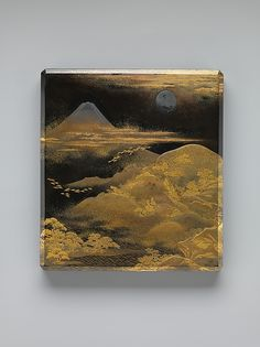 富士飛雁蒔絵硯箱<br/>Box for Inkstone and Writing Implements (Suzuri-bako) with Geese against Mount Fuji in Moonlight and (inner lid) with Plovers by the Seashore | Period: Edo period (1615-1868) Date: eary tomid-19th century, Culture: Japan, Medium: Black lacquer ground with gold and silver 'maki-e: 蒔絵', Dimensions: H. 9 9/16 in. (24.3 cm); W. 8 5/8 in. (21.9 cm); D. 1 13/16in. (4.6 cm), Classification: Lacquer | The Metropolitan Museum of Art