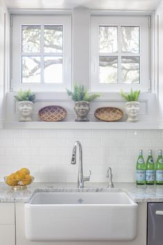 A large farmhouse sink is both attractive and practical for a high-volume kitchen