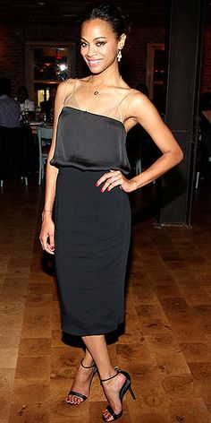 Zoe #Saldana is sleek and stylish in a No. 21 slinky black evening dress, Irene Neuwirth earrings, Jennifer Meyer necklaces and super-strappy sandals
