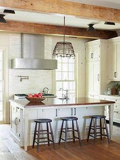 16 Kitchen Island Storage Ideas - Better Homes and Gardens - BHG.com. I love this kitchen with its rustic but open and airy feeling. That island is to die for!
