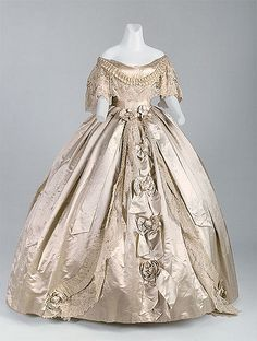 """Worth & Bobergh  Evening gown, 1861 Silk satin, silk ribbon, handmade """"Point de Gaze"""" lace  Charles Frederick Worth and Otto Bobergh founded Worth & Bobergh in Paris in the fall of 1857 or 1858. In 1860, the business appeared in the local trade directory under """"couturiers et nouveautés confectionnées"""" (designers and prepared novelties). By the 1870s, Bobergh was no longer involved with the company, and the House of Worth was well established as the arbiter of fashionable dress.  This gown…"""