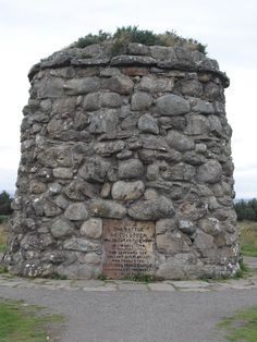 """""""The Battle Of Culloden was fought on this moor, April 16, 1746. The graves of the gallant Highlanders who fought for Scotland & Prince Charlie, are marked by the names of their Clans."""" (The cairn was erected by Duncan Forbes in 1881 and stands 20 feet high.) Culloden is a tract of moorland in the county of Inverness, Scotland, forming a part of the northeast of Drummossie Moor and lying about 6 miles (10 km) east of Inverness."""