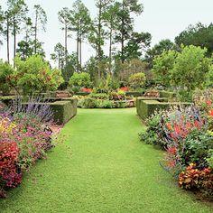 Blooming Courtyard-beautiful flowers, wide walkways, hedge boxes around fruit trees!!