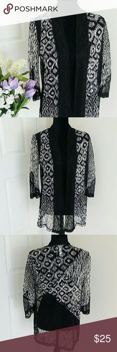 Chicos size (0) small Cardigan NWOT 👉Description : gorgeous traveller's collection l elegant  cardigan l versatile l fits great l shear see through  l 3/4 sleeves.   👉Material :  88% polyester 12% spandex. 👉Color :  black and white.  👉Condition:  perfect new never worn l No holes l No stains l No stains l No snags l No damage. 👉 Measurements will be provided on request.  👉Discount  with  bundles. No trades 🚫 chicos Tops