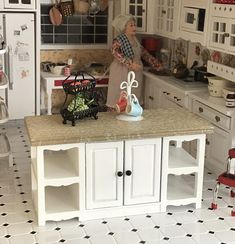 ***Listing if for dollhouse 1:12 scale miniature*** Add some style and cooking/serving space to your dollhouse kitchen with this pretty, White center island table. Side shelves and storage on both sides for all those dishes, pots, pans and tiny kitchen supplies Note: Listing includes 1