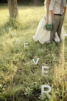 Spell something out in the grass with simple letters you can buy at any craft store.