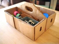 Cardboard Tool Box. This is what I need to carry paints, brushes, etc from my closet to the kitchen table..