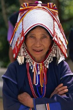Northern Thailand | An Akha Hill tribe woman wearing a traditional silver headpiece in Chiang Rai | © Travel Pix Collection