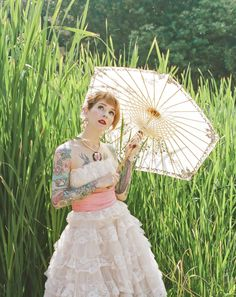 Tattooed Bride with a lovely vintage dress and parasol!