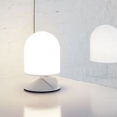 With an unadorned exterior our studio has created Vinge, a table lamp with a movable wing that encourages interaction.