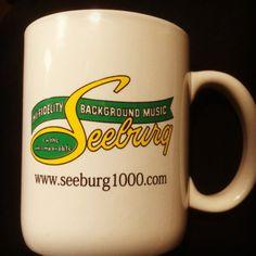 A coffee cup with the Seeburg Logo at www.seeburg1000.com