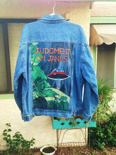 Judgment on Janus scifi book cover custom painted on denim jacket by @bleudoor on Instagram