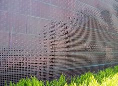 Perforated copper facade. de young museum san francisco herzog de meuron
