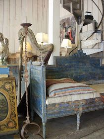 The layered paint finish on this daybed at a Paris flea market is awesome!