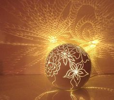 Ceramic ball lamp shines amazing designs on the wall to illuminate your imagination!