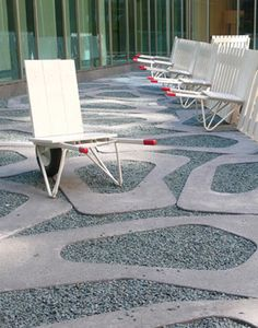 loose set cut concrete with gravel... love this!  The chair carts are pretty swanky too!