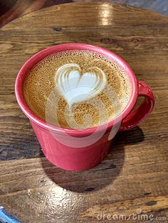 Hot latte served with an artistic twist: A cute heart design created in the milk foam.