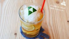 I found this in an interesting article on zeldadungeon.net.  A refreshing drink with a Triforce cut from citrus peels (in this case, lime).  I'm so going to try this!