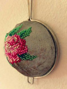 Cross stitched old strainer