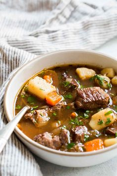BEST Irish Beef Stew! Made with beef, garlic, stock, Irish Guinness stout, red wine, potatoes, carrots, and onions. A hearty stew perfect for celebrating St. Patrick's Day! On SimplyRecipes.com #BeefStew