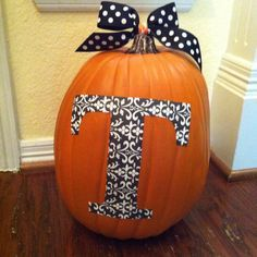 Initial pumpkin. Enlarged the letter and traced onto scrapbook paper. Mod Podge as adhesive. A bow on the top makes everything better!
