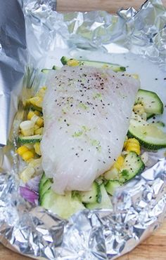 Coconut-Lime White Fish Packets for the Grill packed with fresh summer veggies: corn, zucchini, and shallots.