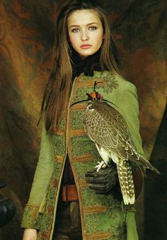 I love this photograph - beautiful woman wearing a fabulous coat with a falcon.