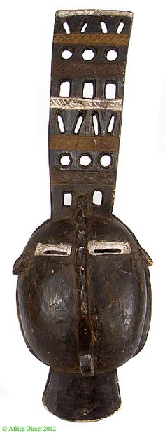 Title: Igbo Mask with Superstructure Unusual Nigeria African Type of Object: mask Ethnic Group: Igbo Country of Origin: Nigeria Materials: Wood, pigment Approximate Age: mid 20th century