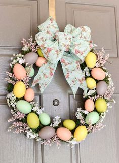 DIY Easter Egg Wreath - create a beautiful Spring wreath with easter eggs, moss, and flowers. Add a pink and mint floral bow and you have a pretty DIY Easter egg wreath to welcome guests. Hoppy Easter, Easter Eggs, Easter Table, Diy Easter Decorations, Easter Wreaths Diy, Outdoor Decorations, Thanksgiving Decorations, Homemade Decorations, Easter Centerpiece