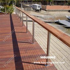 deck railing photo gallery stainless steel cable railing with wooden handrail backyard. Black Bedroom Furniture Sets. Home Design Ideas