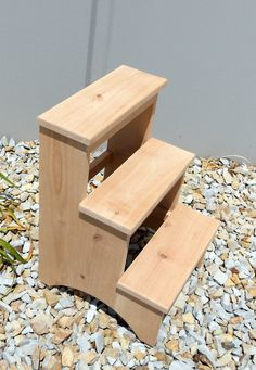 "Shaker Inspired Rustic Alder 3-Step Stool, Unfinished  This sturdy stool would be a great addition to any country home or mountain retreat décor. A great item to help reach those top shelves in the kitchen or to boost a child's reach. - The stool is made of solid Rustic Alder. - The stool overall size is 19 1/2"" tall by 15"" wide by 15 in depth. - Each step is 3/4"" thick and is 6 1/2 high. - All the joints are reinforced with wood screws hidden with the matching wood plugs. - For small knots… 3 Step Stool, Kitchen Step Stool, Diy Stool, Trampoline Steps, Murphy Bunk Beds, Ladder Chair, Diy Home Furniture, Wood Steps, Wood Plugs"